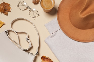 Flat lay composition with stylish hat on beige background