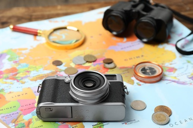 Different travel accessories on world map. Planning summer vacation trip