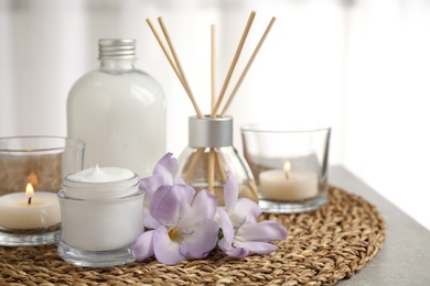 Composition with skin care products and reed air freshener on light background