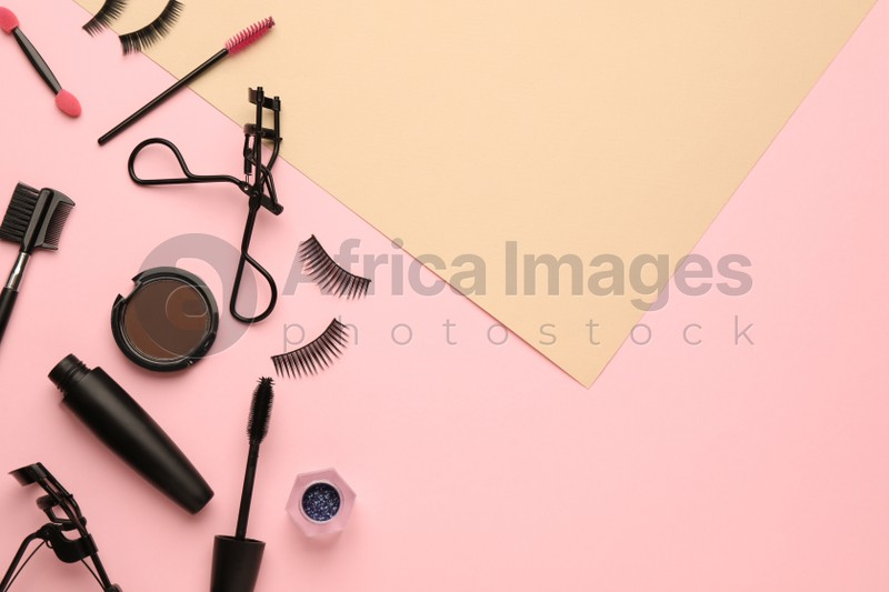 Flat lay composition with eyelash curler, makeup products and accessories on color background. Space for text