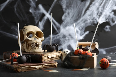 Different Halloween themed cake pops on black table