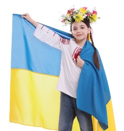 Little girl in national clothes with flag of Ukraine on white background