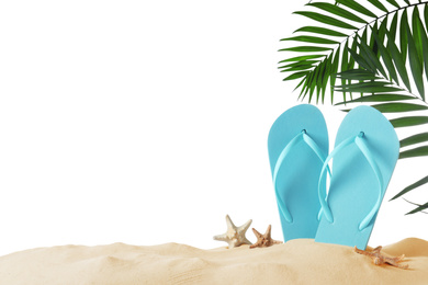 Light blue flip flops and starfishes on sand against white background. Beach objects