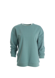 Stylish sweater on mannequin against white background. Trendy clothes