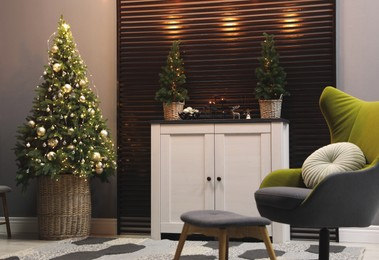 Beautiful room interior with decorated Christmas tree and modern furniture