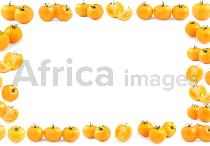 Frame made of fresh ripe yellow tomatoes on white background