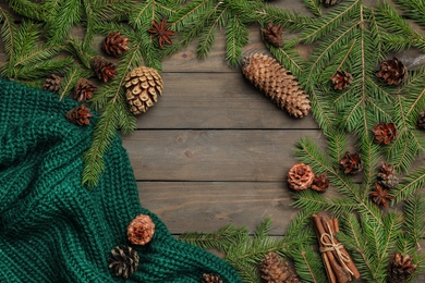 Flat lay composition with pinecones on wooden background. Space for text