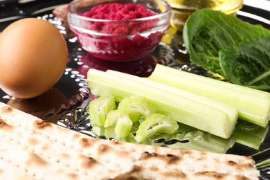 Closeup view of Passover Seder plate (keara) with traditional meal. Pesah celebration