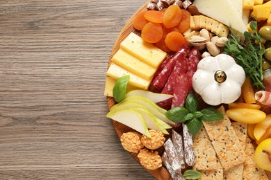 Different tasty appetizers on wooden table, top view. Space for text