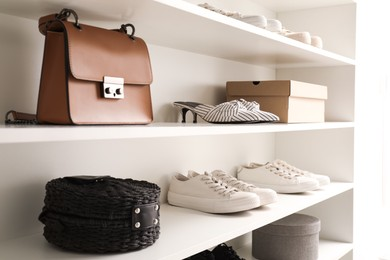Storage rack with stylish women's shoes and accessories indoors