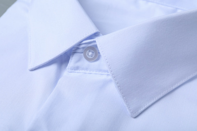 Closeup view of stylish white shirt. Dry-cleaning service