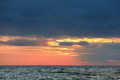 Picturesque view of beautiful sky with clouds over sea at sunset