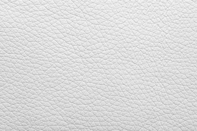 Texture of light leather as background, closeup