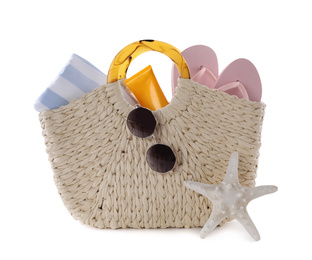 Bag with different beach objects and starfish on white background
