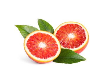 Cut ripe red orange with green leaves isolated on white