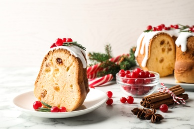 Composition with piece of traditional homemade Christmas cake on white marble table, closeup
