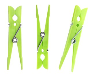 Set with green plastic clothespins on white background