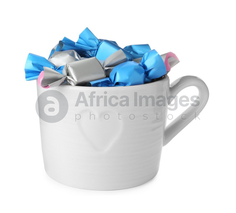 Cup with candies in colorful wrappers isolated on white