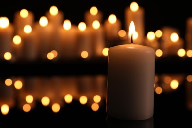 Burning candle in darkness, space for text. Memory day