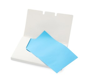 Open package of facial oil blotting tissues on white background
