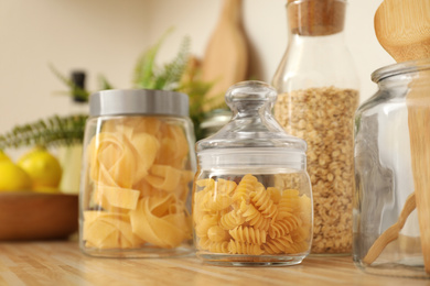 Jars with products on wooden kitchen countertop
