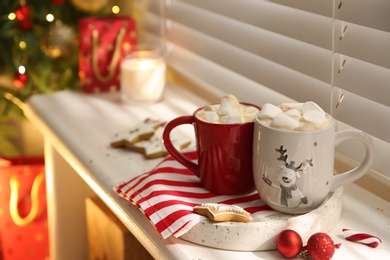 Composition with cup of hot drink on windowsill