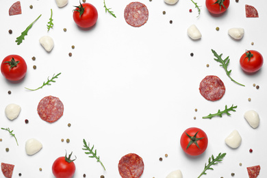 Composition with fresh ingredients and space for text on white background, top view. Pepperoni pizza recipe