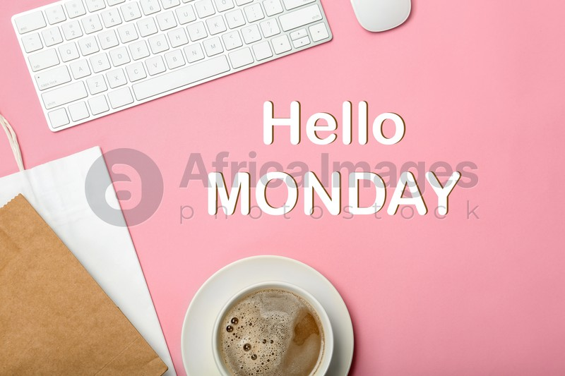 Hello Monday, start your week with good mood. Cup of coffee, shopping bags and keyboard on pink background, flat lay