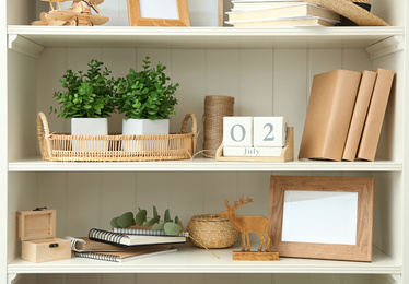 White shelving unit with different decorative elements