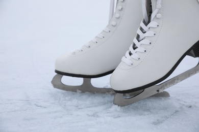Figure skates with laces on ice. Winter outdoors activities