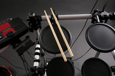 Modern electronic drum kit on grey background, above view. Musical instrument