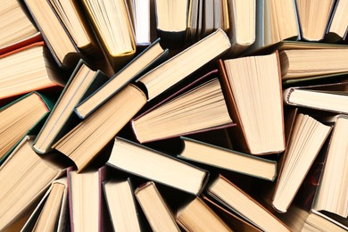 Many hardcover books as background, top view. Library material