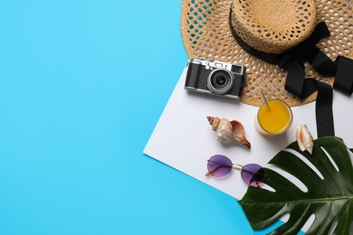 Flat lay composition with different beach objects on color background, space for text