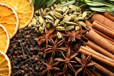 Different mulled wine ingredients as background, closeup