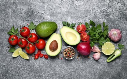 Fresh ingredients for guacamole on grey table, flat lay