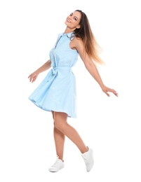 Full length portrait of happy young woman in dress on white background