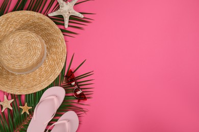 Flat lay composition with beach objects on pink background, space for text