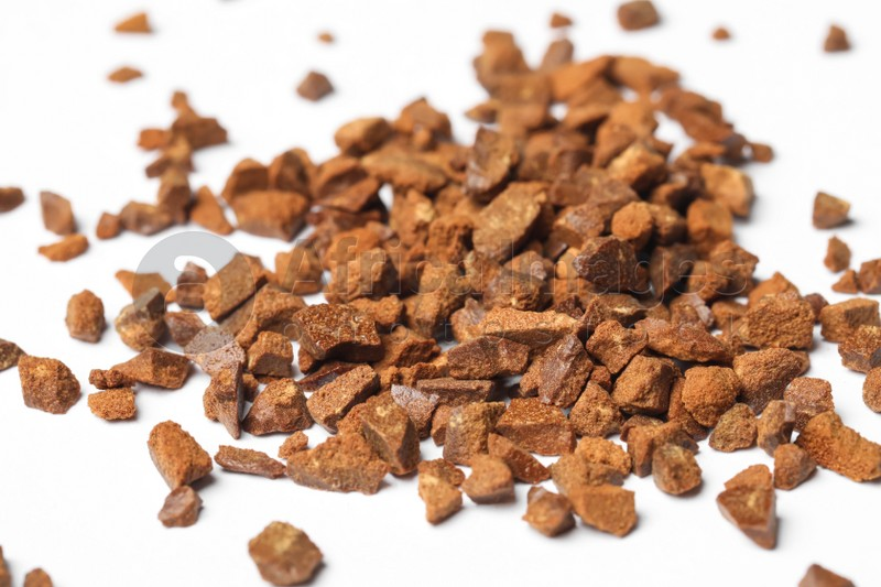 Pile of chicory granules on white background, closeup