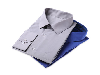 Stylish shirts isolated on white. Dry-cleaning service