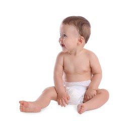 Cute baby in dry soft diaper sitting isolated on white