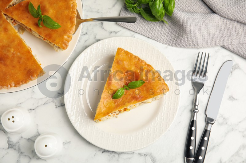 Delicious pie with meat and basil on white marble table, flat lay
