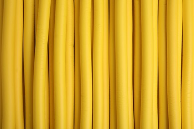 Curling rods as background, closeup. Hair styling tool