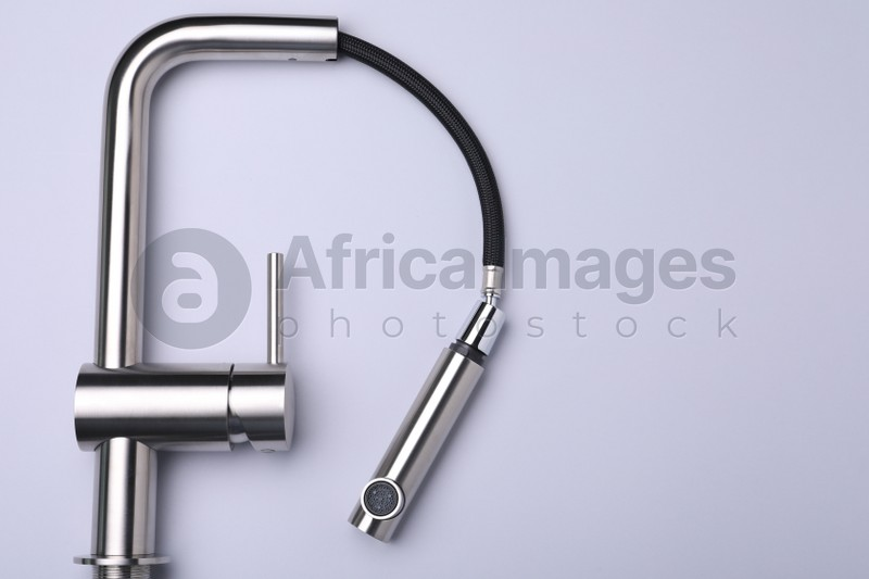 Modern pull out kitchen faucet on grey background, top view. Space for text