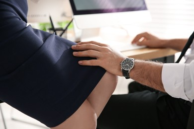 Man flirting with his colleague during work in office, closeup