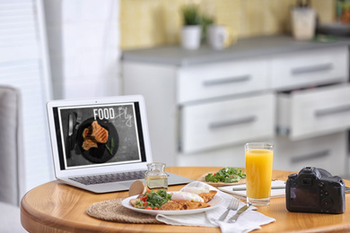 Delicious lunch served on table with laptop. Food blog