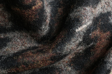 Texture of beautiful fabric with animal pattern as background, closeup