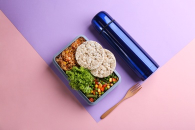 Thermos, lunch box with food on color background, flat lay