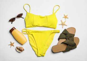 Flat lay composition with beach objects on white background