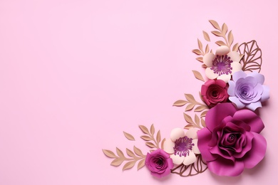 Different beautiful flowers and branches made of paper on pink background, flat lay. Space for text