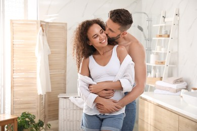 Lovely couple enjoying each other in bathroom at home